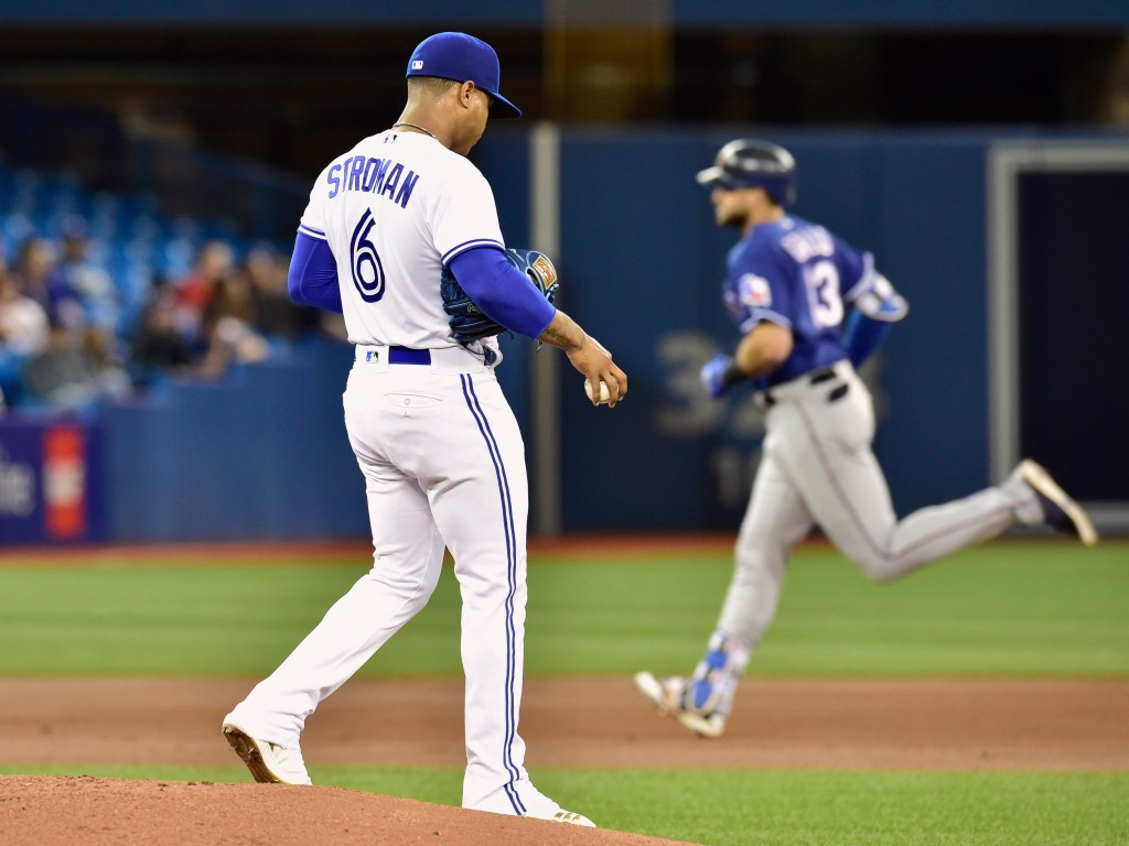 Texas Rangers' Joey Gallo (13) rounds the bases after hitting a two-run home run off Toronto Blue Jays starting pitcher Marcus Stroman (6) during the ...