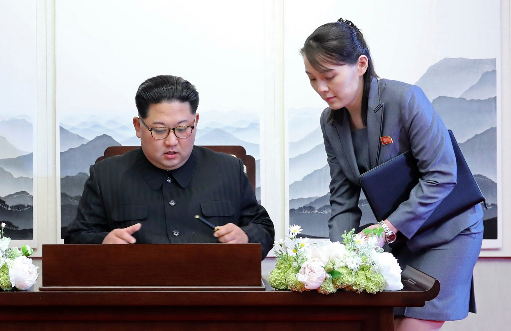 FILE - In this Friday, April 27, 2018, file photo, North Korean leader Kim Jong Un signs a guestbook next to his sister Kim Yo Jong, right, inside the...