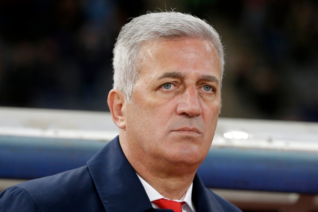 In this photo taken on Friday, March 23, 2018, Switzerland coach Vladimir Petkovic stands for the national anthem of his team before an international ...