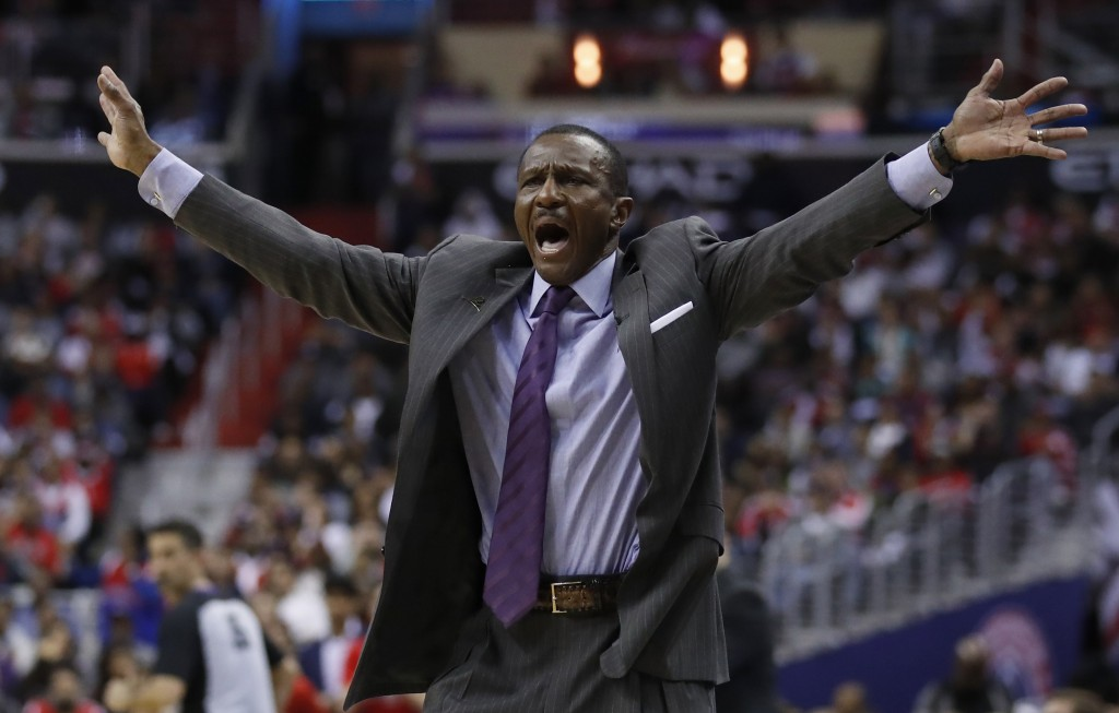 Toronto Raptors coach Dwane Casey call for a timeout in the second half of Game 6 of an NBA basketball first-round playoff series against the Washingt...