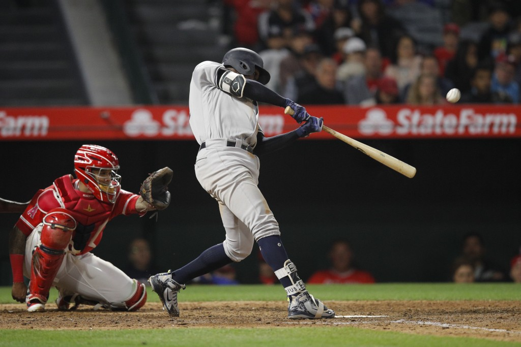 New York Yankees' Didi Gregorius hits a home run during the 10th inning of the team's baseball game against the Los Angeles Angels, Friday, April 27, ...