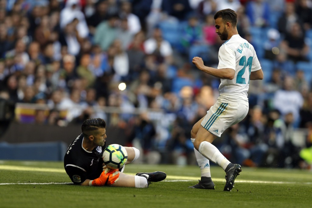 Real Madrid's Borja Mayoral, right, challenges Leganes goalkeeper Ivan Cuellar during a Spanish La Liga soccer match between Real Madrid and Leganes a...