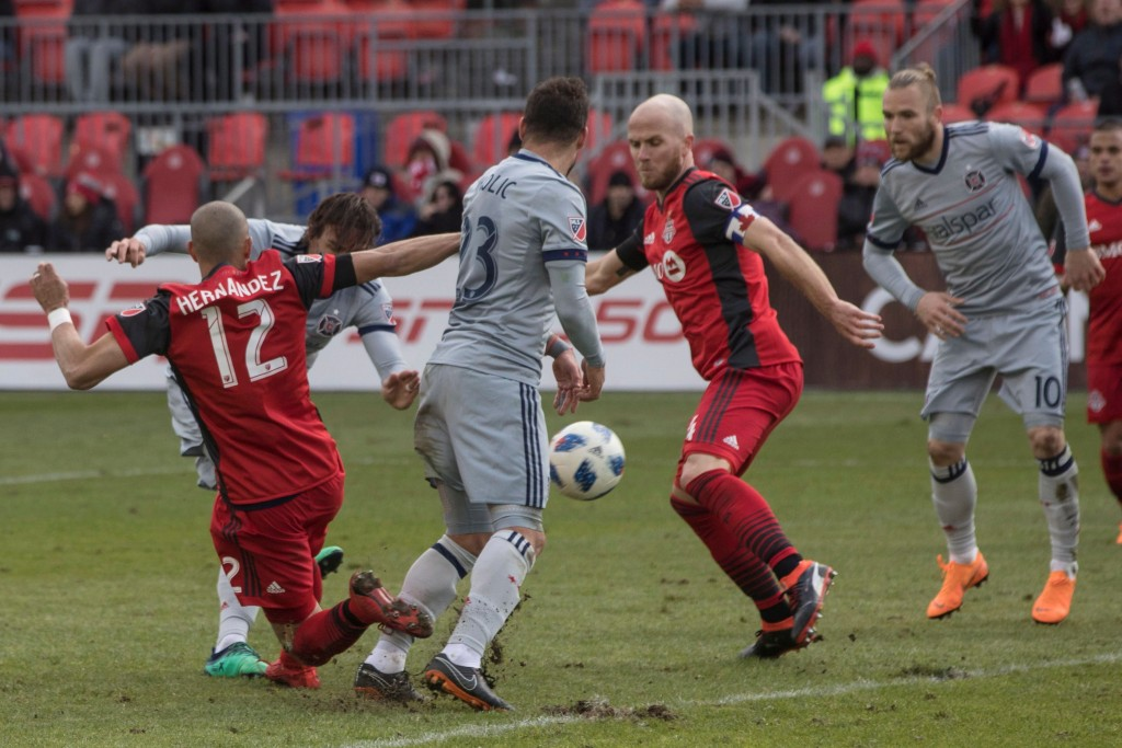 Chicago Fire's Alan Gordon, obscured at left, scores against Toronto FC during second half MLS soccer action in Toronto on Saturday, April 28, 2018. (...