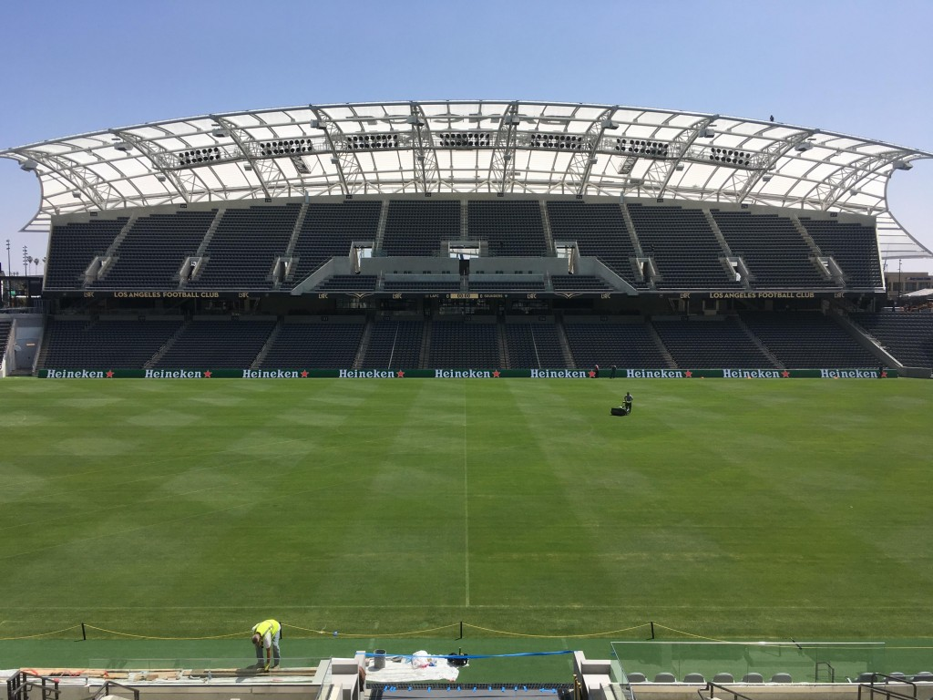 In this April 26, 2018, photo workers prepare the playing field at Banc of California Stadium for its official opening Sunday, April 29, and the upcom...