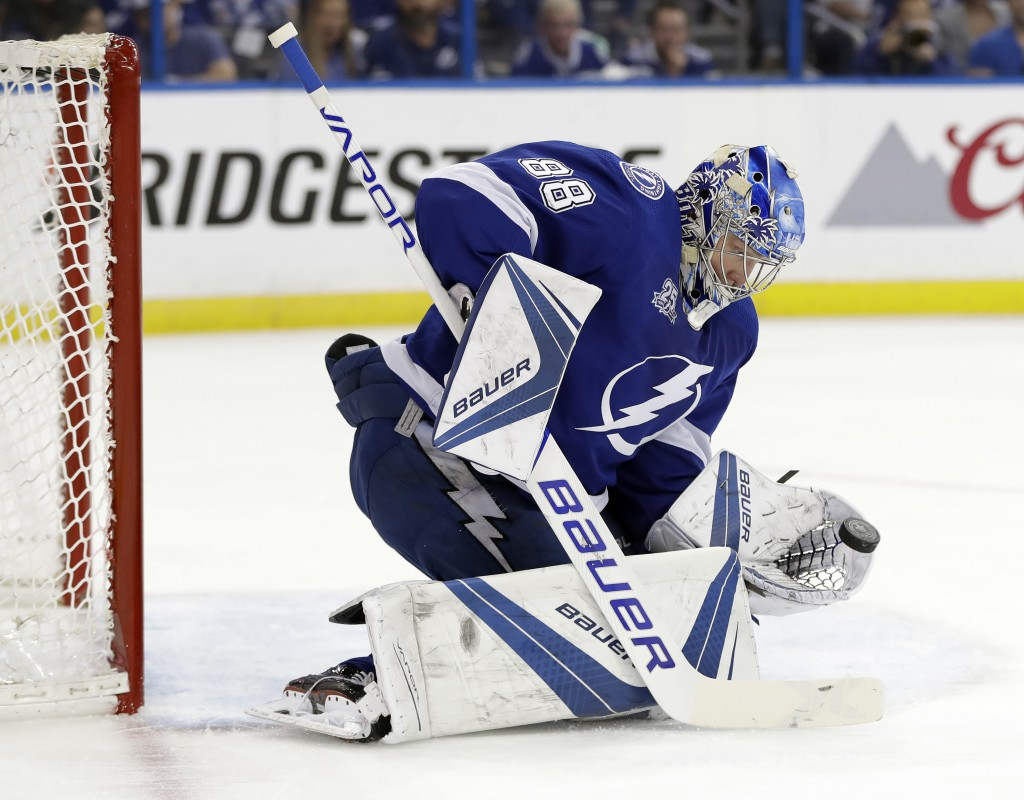 Tampa Bay Lightning goaltender Andrei Vasilevskiy (88) makes a glove-save on a shot by the Boston Bruins during the first period of Game 1 of an NHL s...