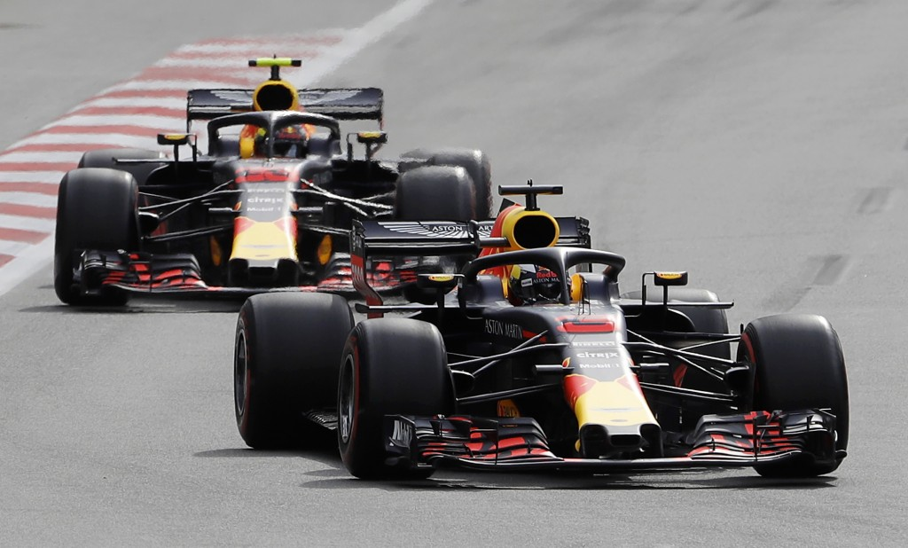 Australia driver Daniel Ricciardo, bottom, steers his Red Bull followed by his teammate Red Bull driver Max Verstappen, of the Netherlands, during the...