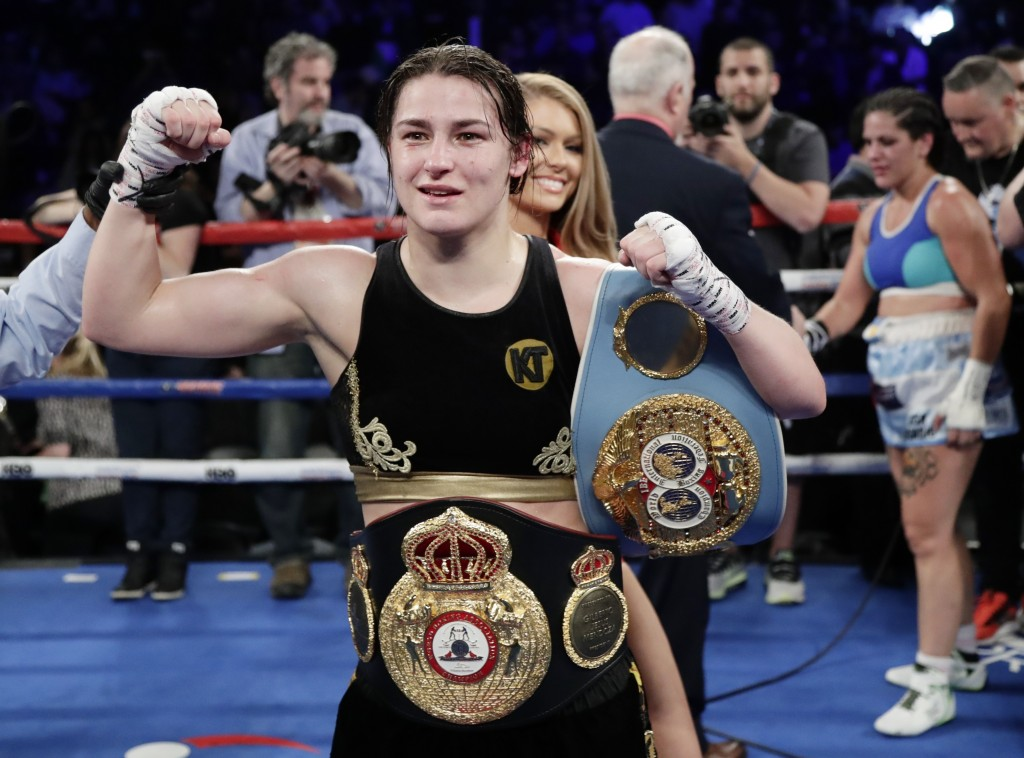 Ireland's Katie Taylor poses for photographs after winning a women's lightweight championship boxing match against Argentina's Victoria Noelia Bustos,...