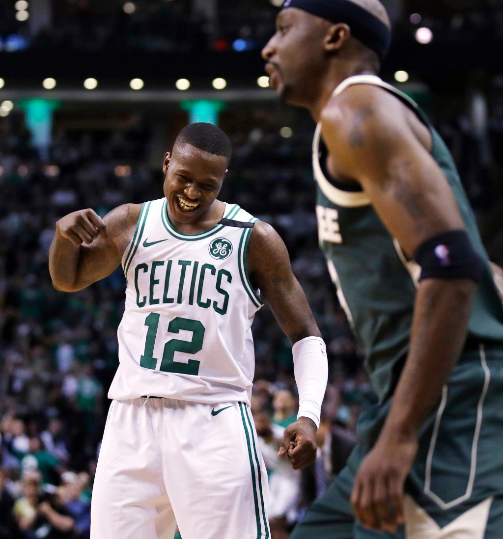 Boston Celtics guard Terry Rozier (12) celebrates after a basket against the Milwaukee Bucks during the fourth quarter of Game 7 of an NBA basketball ...