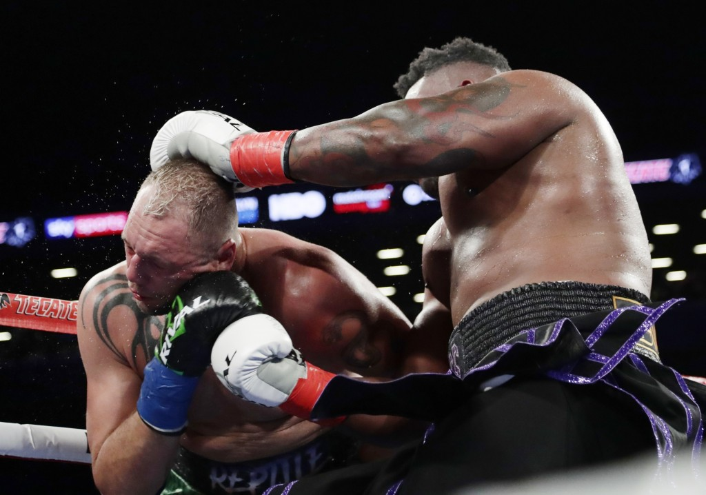 Jarrell Miller, right, punches Johann Duhaupas, of France, during the fifth round a heavyweight boxing match Saturday, April 28, 2018, in New York. Mi...