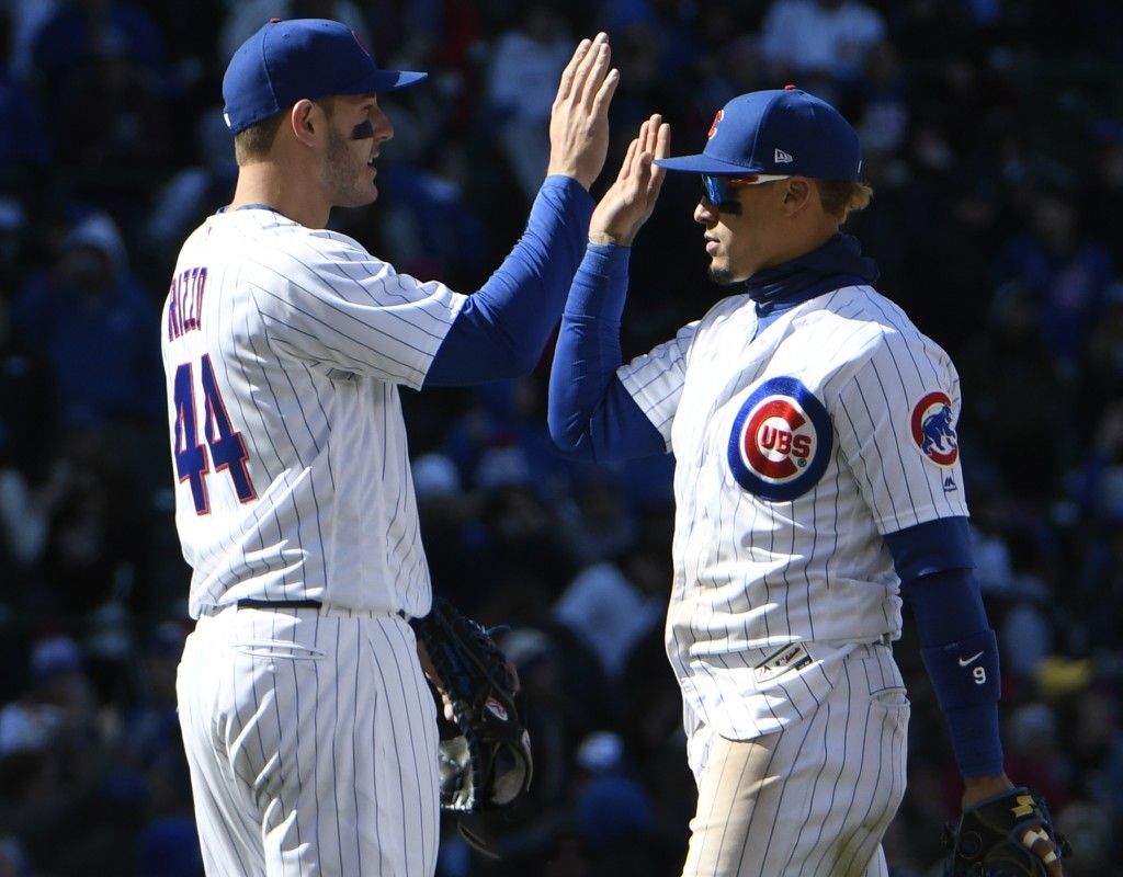 Chicago Cubs first baseman Anthony Rizzo (44) and Chicago Cubs second baseman Javier Baez (9) celebrate their win against the Milwaukee Brewers in a b...