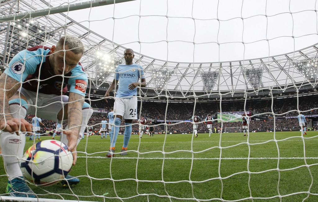 West Ham United's Marko Arnautovic, left, retrieves the ball after his teammate Aaron Cresswell scored his side's first goal, with Manchester City's F...