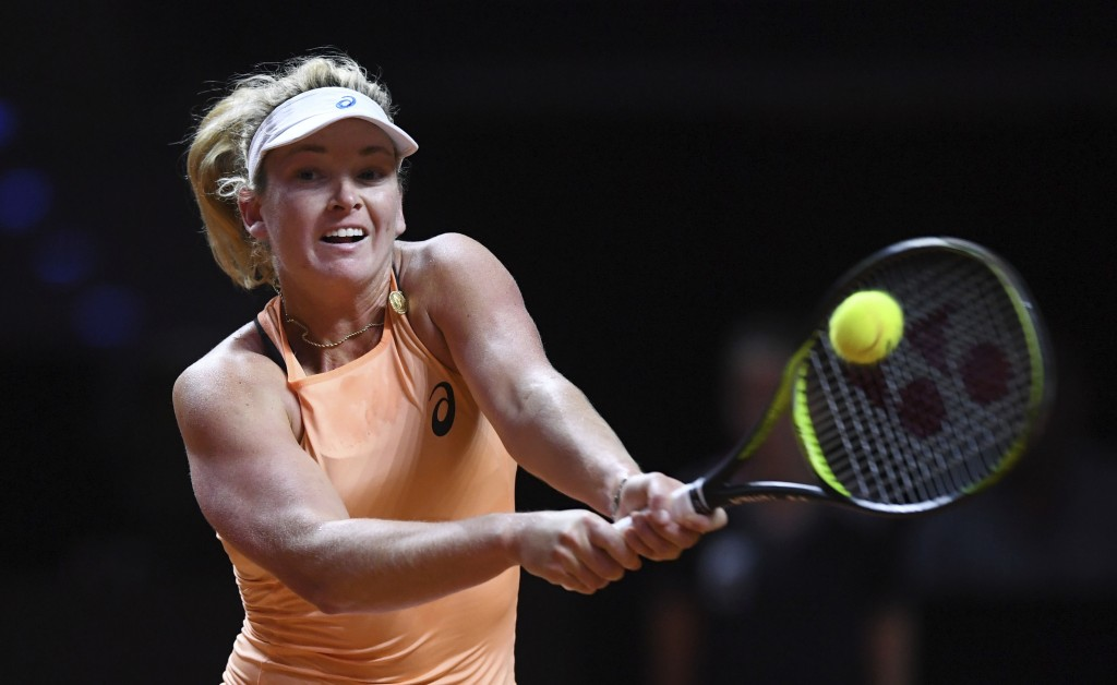 Coco Vandeweghe from the U.S. returns a shot to France's Caroline Garcia, in their semifinal match of the WTA tennis tournament in Stuttgart, Germany,...