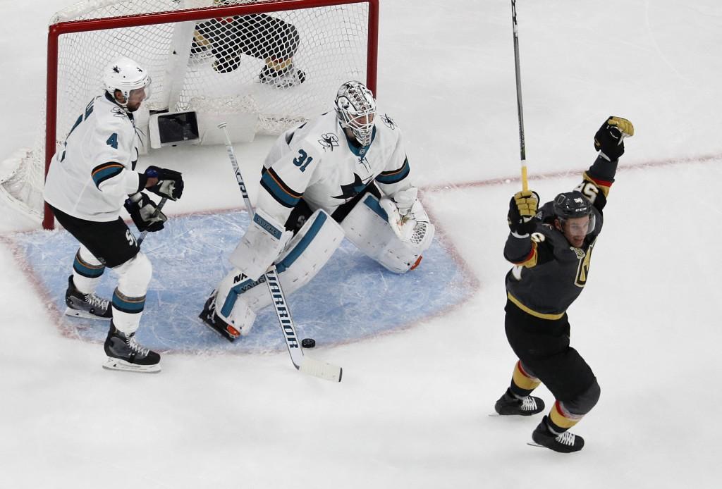Vegas Golden Knights left wing Erik Haula (56) celebrates after a teammate scored against San Jose Sharks goaltender Martin Jones (31) during the thir...