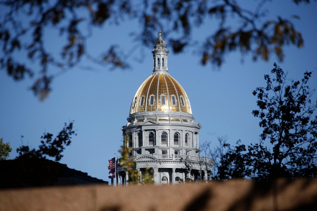 FILE - In this Nov. 3, 2015, file photo, the gold-covered dome on the state Capitol shines in the late afternoon sun in downtown Denver. Democrats buo...