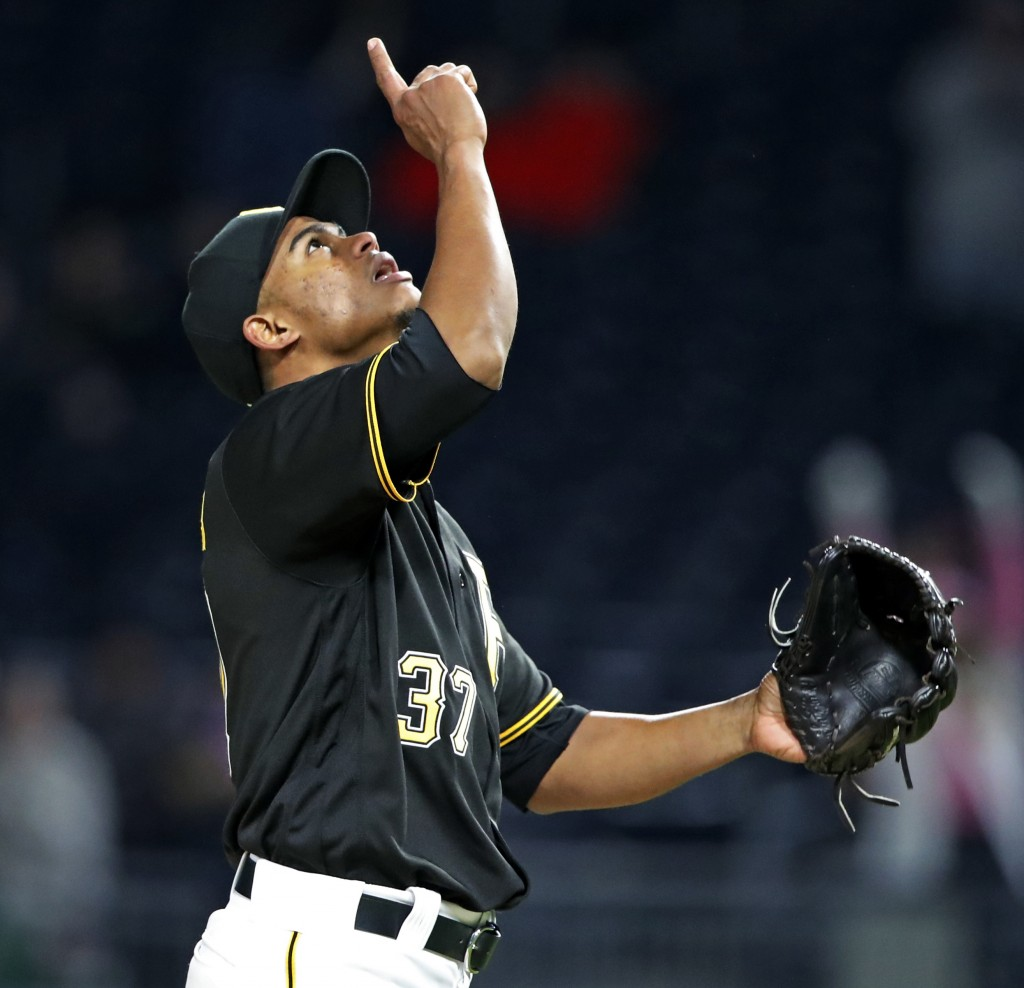 Pittsburgh Pirates relief pitcher Edgar Santana celebrates getting the final out of a 6-2 Pirates win over the St. Louis Cardinals in a baseball game ...