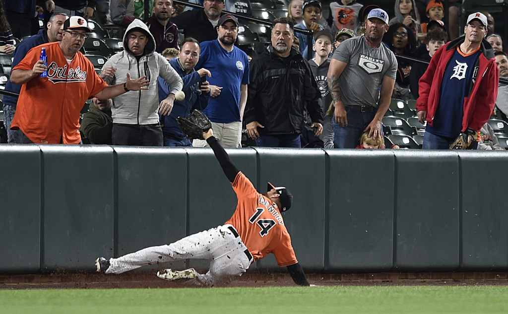 Baltimore Orioles left fielder Craig Gentry catches a foul ball hit by Detroit Tigers Victor Martinez in the fourth inning of baseball game, Saturday,...
