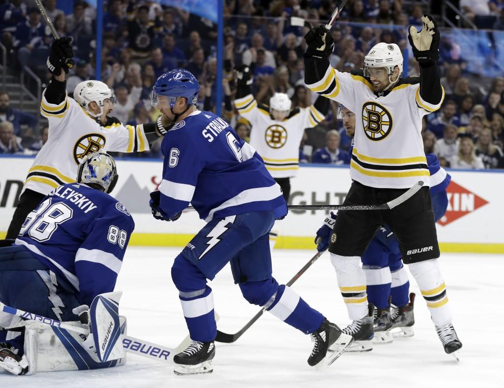 Boston Bruins left wing Rick Nash, right, celebrates after scoring past Tampa Bay Lightning goaltender Andrei Vasilevskiy, left, during the first peri...