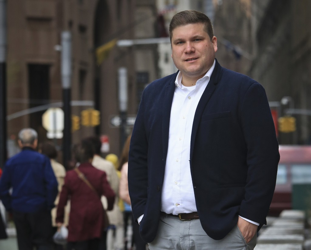 Omar Gonzalez-Pagan, lawyer for the LGBT civil rights group Lambda Legal, poses outside his Manhattan office, Friday April 27, 2018, in New York. Mili...