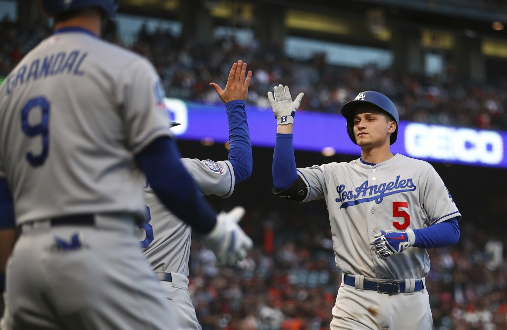 Los Angeles Dodgers' Corey Seager, right, is congratulated by Chris Taylor and Yasmani Grandal (9) after hitting a two-run home run off San Francisco ...