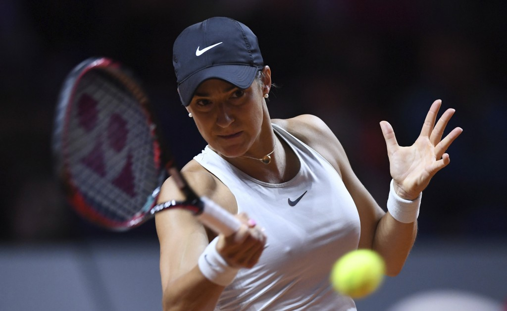 Caroline Garcia returns a shot to Coco Vandeweghe from the U.S. during their semifinal match of the WTA tennis tournament in Stuttgart, Germany, Satur...