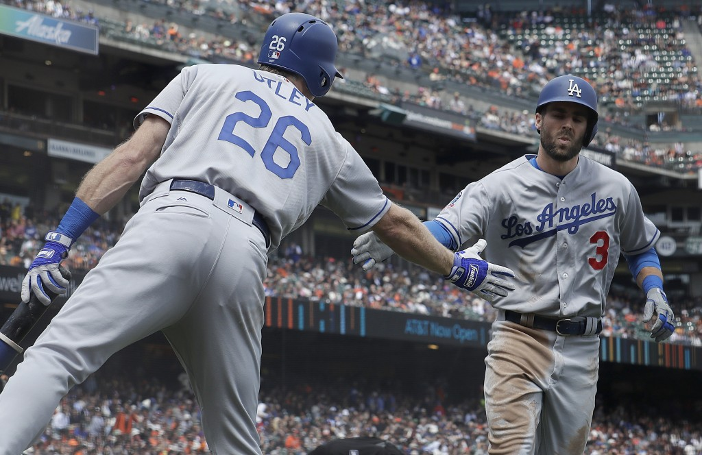 Los Angeles Dodgers' Chris Taylor, right, is congratulated by Chase Utley after hitting a solo home run against the San Francisco Giants during the se...