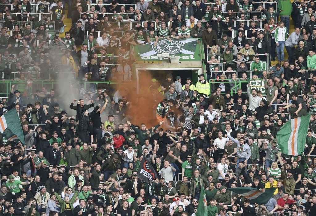 Celtic fans celebrate after the second Celtic goal, during the Scottish Premiership soccer match between Celtic and Rangers at Celtic Park, in Glasgow...