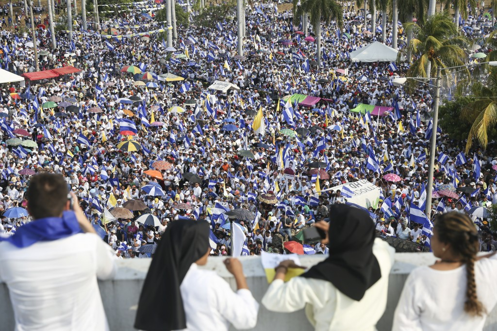 Thousands of people congregate outside Managua's Cathedral during a massive march called by the Catholic Church as a day of prayer, in Managua, Nicara...