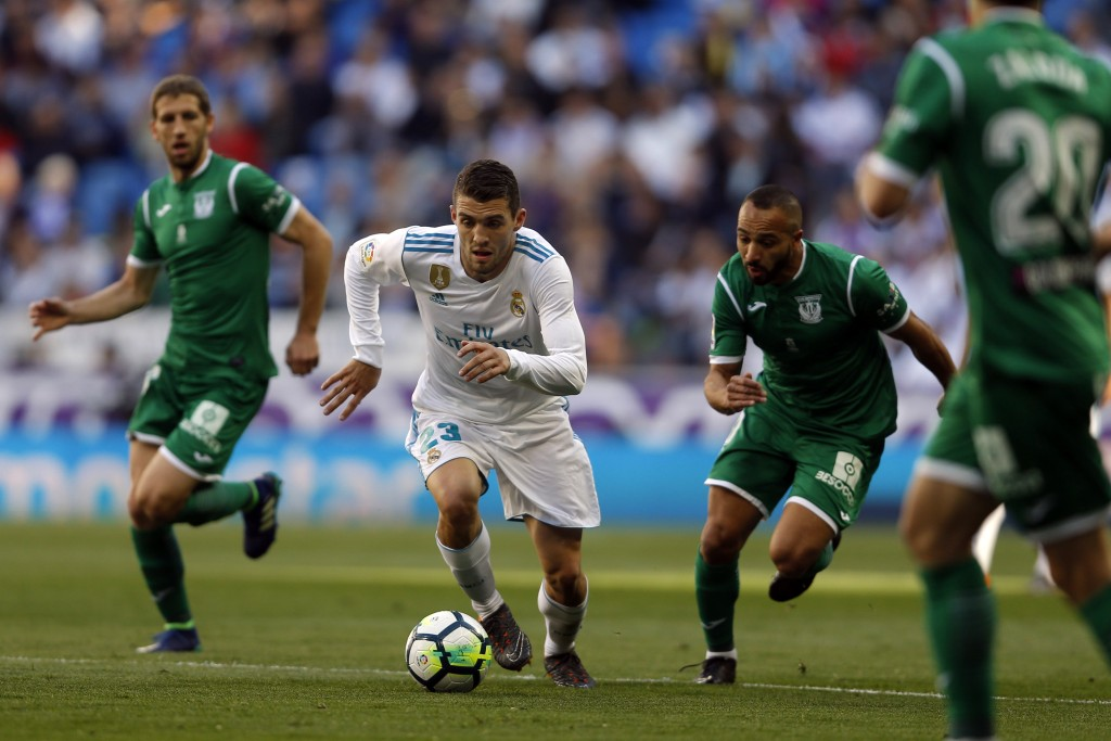 Real Madrid's Mateo Kovacic, left, vies for the ball with Leganes' Nabil El Zhar during a Spanish La Liga soccer match between Real Madrid and Leganes...
