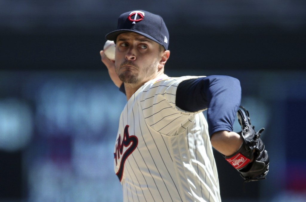 Minnesota Twins pitcher Jake Odorizzi throws against the Cincinnati Reds in the first inning of a baseball game Saturday, April 28, 2018, in Minneapol...