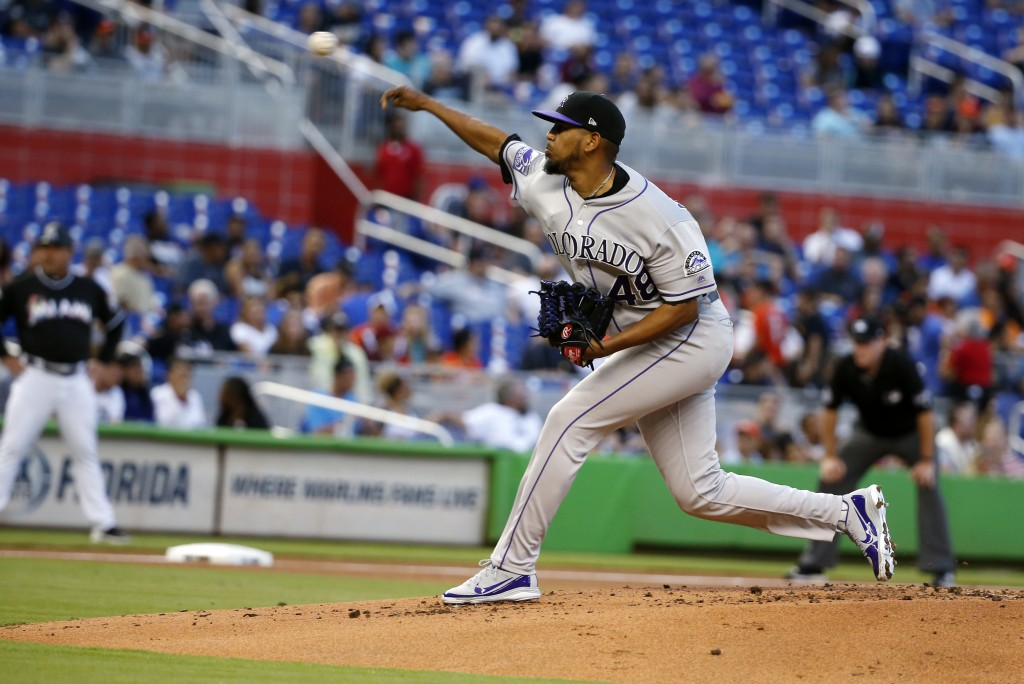 Colorado Rockies' German Marquez delivers a pitch during the first inning of a baseball game against the Miami Marlins, Saturday, April 28, 2018, in M...