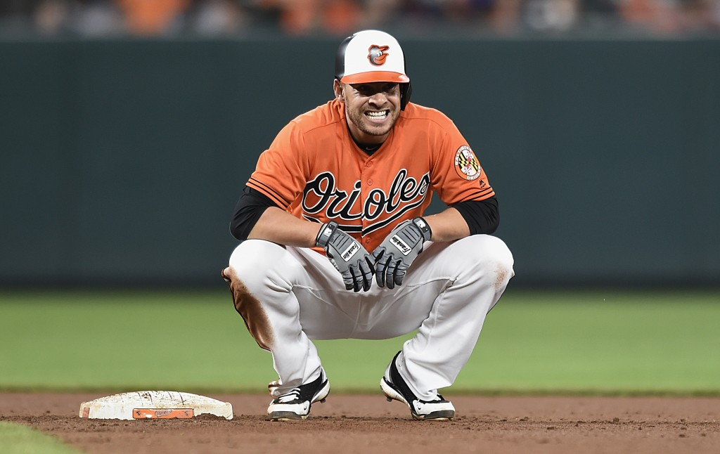 Baltimore Orioles' Danny Valencia grimaces after being forced out at second on a ground ball hit by Joey Rickard during the fourth inning of baseball ...