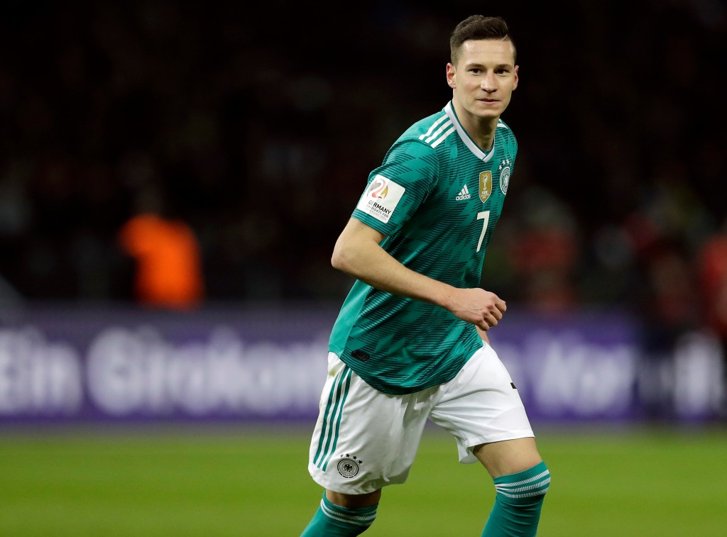 In this photo taken on Tuesday, March 27, 2018,Germany's Julian Draxler smiles during the international friendly soccer match between Germany and Braz...