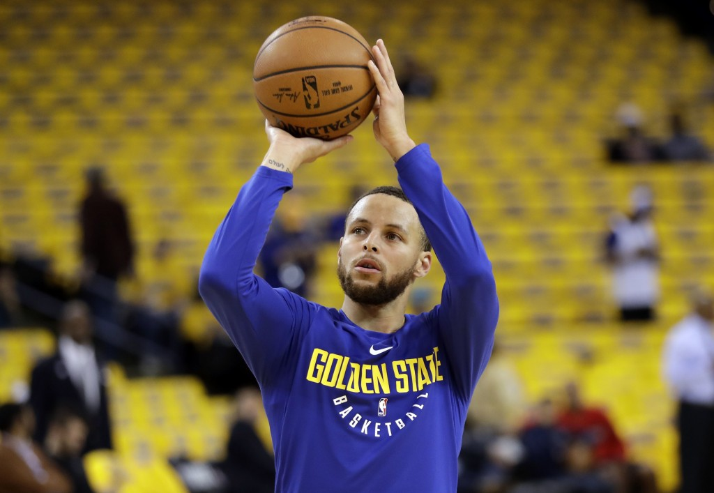 Golden State Warriors' Stephen Curry shoots during warmups before Game 1 of an NBA basketball second-round playoff series against the New Orleans Peli...
