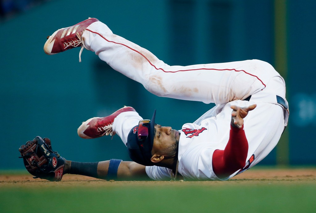 Boston Red Sox's Eduardo Nunez falls on his back while fielding the cut off throw on an RBI double by Tampa Bay Rays' Jesus Sucre during the eighth in...