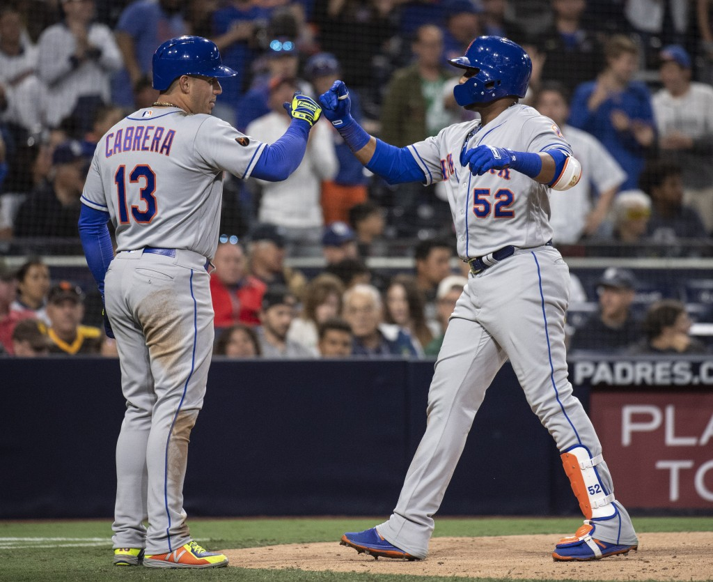 New York Mets' Yoenis Cespedes, right, celebrates his two-run home run with Asdrubal Cabrera during the sixth inning of a baseball game against the Sa...