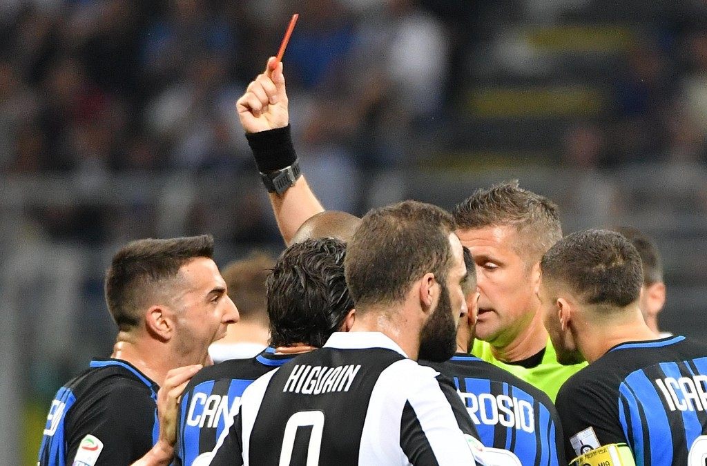 Referee Daniele Orsato shows a red card to Inter Milan's Matias Vecino during the Serie A soccer match between Inter Milan and Juventus at the San Sir...