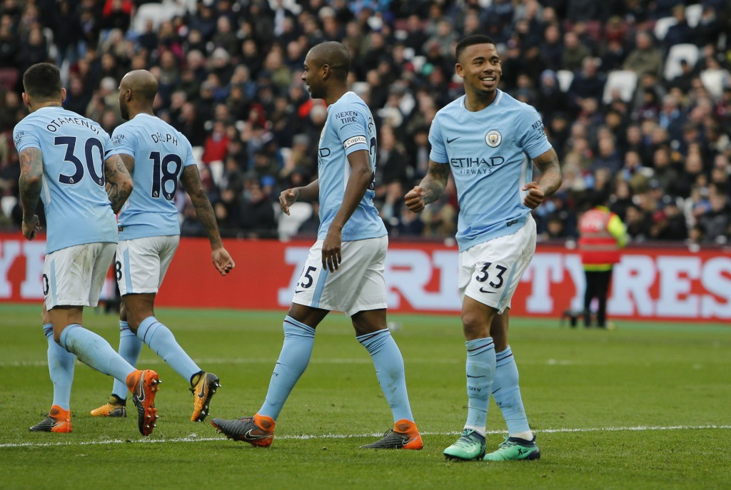 Manchester City's Gabriel Jesus, right, celebrates after scoring his side's third goal during the English Premier League soccer match between West Ham...