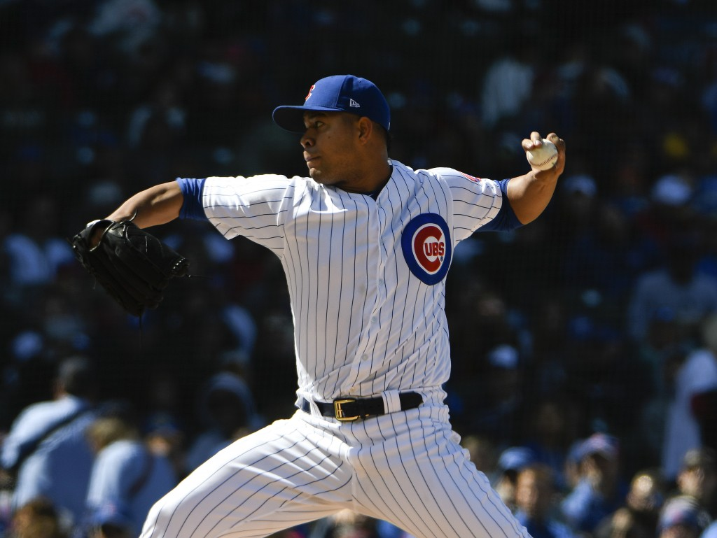 Chicago Cubs starting pitcher Jose Quintana throws the ball against the Milwaukee Brewers during the sixth inning of a baseball game, Saturday, April ...