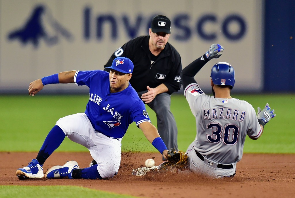 Texas Rangers right fielder Nomar Mazara (30) slides safely in to second base ahead of the tag from Toronto Blue Jays third baseman Yangervis Solarte ...