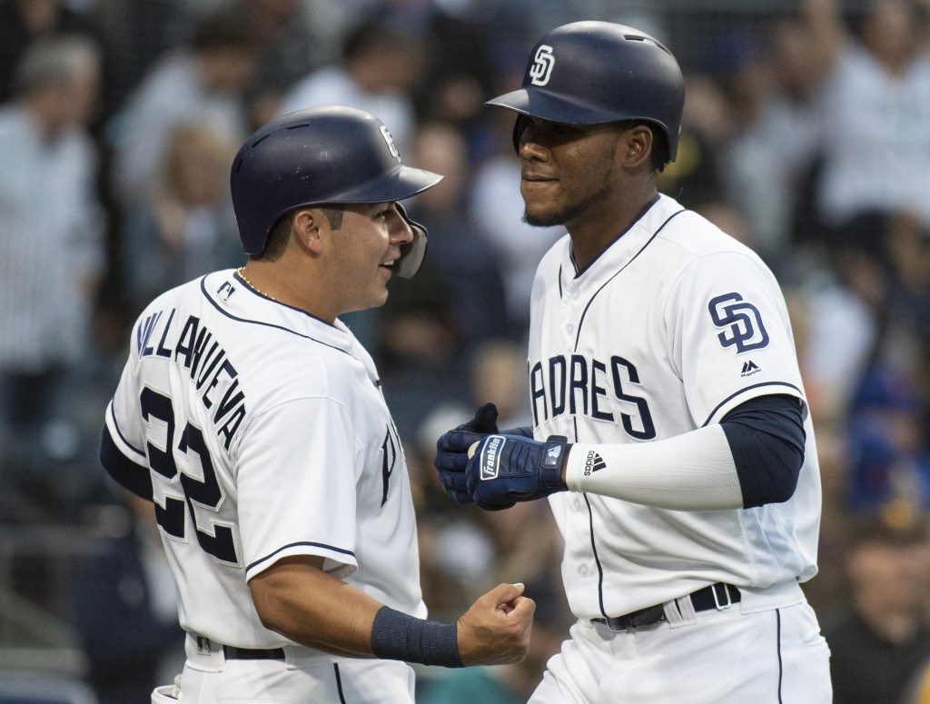 San Diego Padres' Franchy Cordero, right, and Christian Villanueva celebrate Cordero's three-run home run during the fourth inning of a baseball game ...