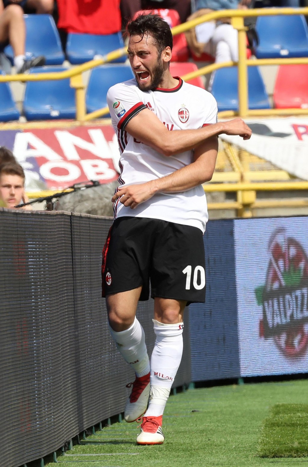 AC Milan's Hakan Calhanoglu celebrates after scoring during a serie A soccer match between Bologna and AC Milan at the Dall'Ara stadium, in Bologna, I...