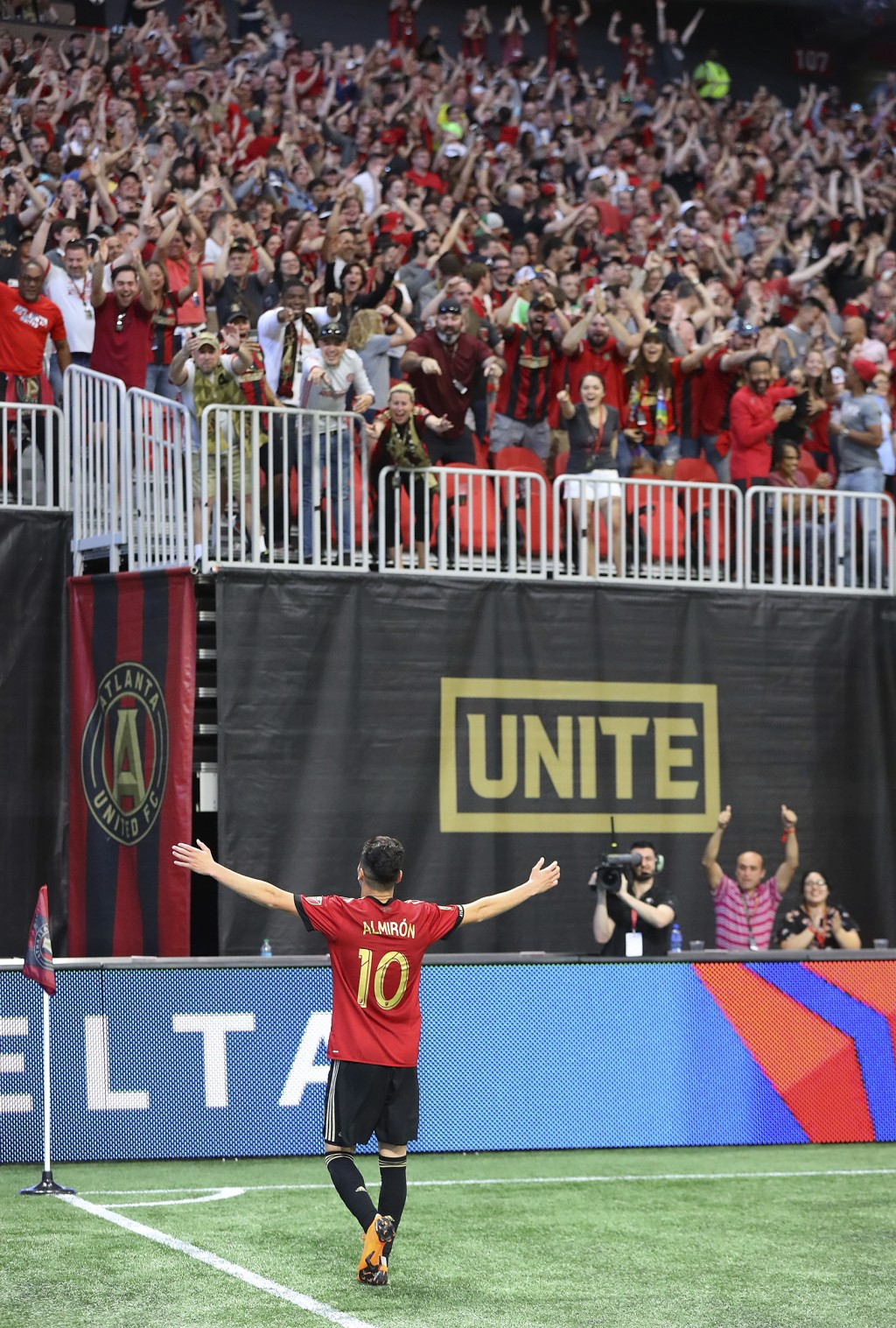 Atlanta United midfielder Miguel Almiron plays to the fans after scoring a goal over Montreal Impact during the second half of an MLS soccer game on S...