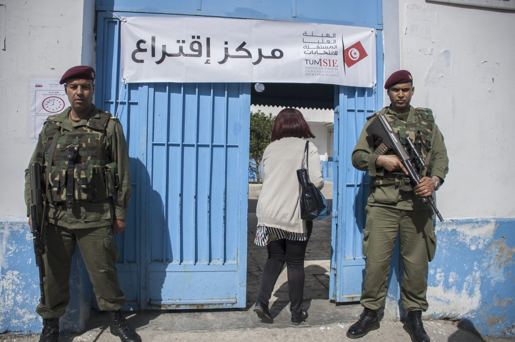 Tunisian soldiers stand guard outside a municipal elections polling station for the police and military in Tunis, Sunday, April 29, 2018. This is the ...