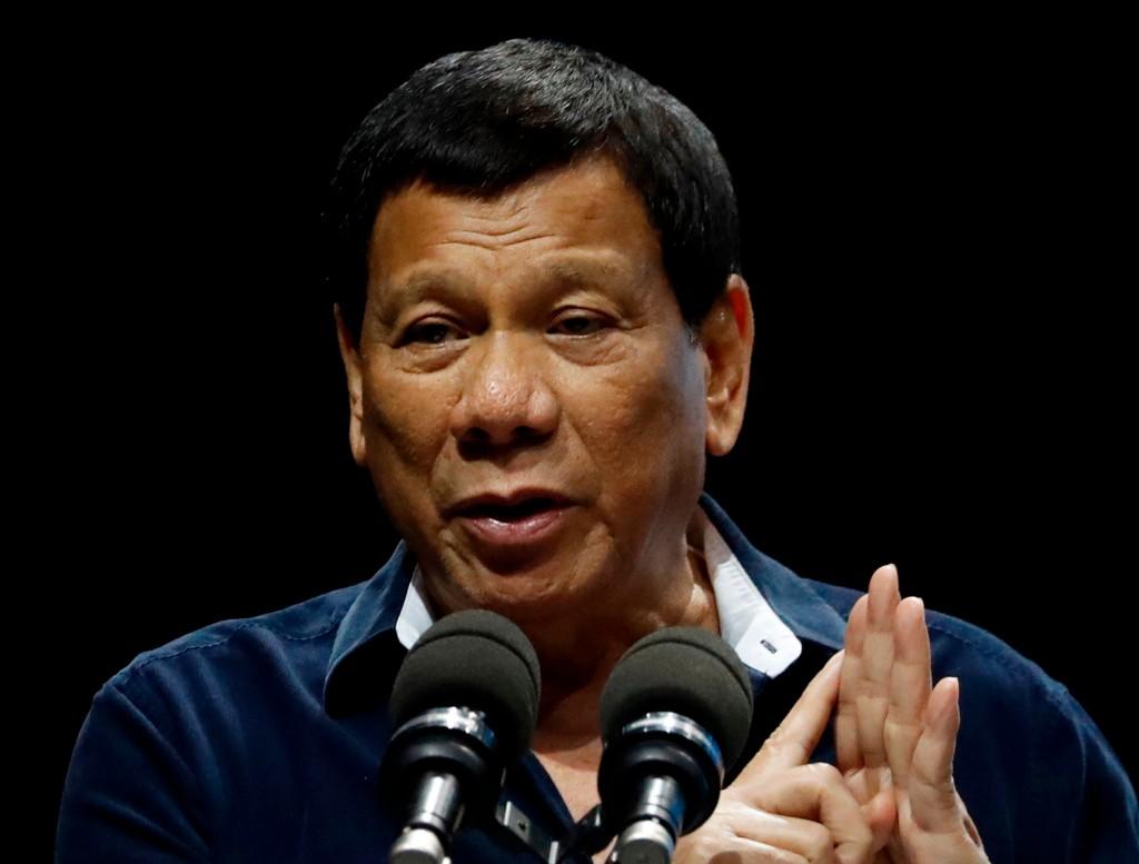 FILE - In this Saturday, April 28, 2018, file photo, Philippine President Rodrigo Duterte addresses the Filipino community in Singapore. Duterte said ...