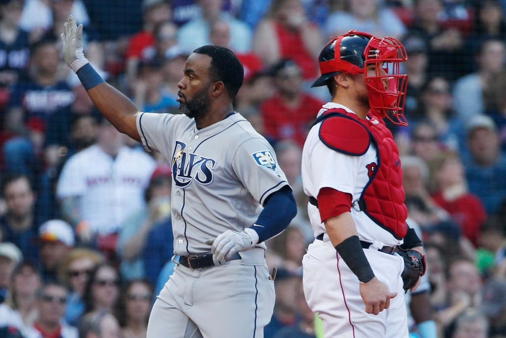 Tampa Bay Rays' Denard Span, left, celebrates behind Boston Red Sox's Christian Vazquez after scoring on an error by Jackie Bradley Jr. during the sec...