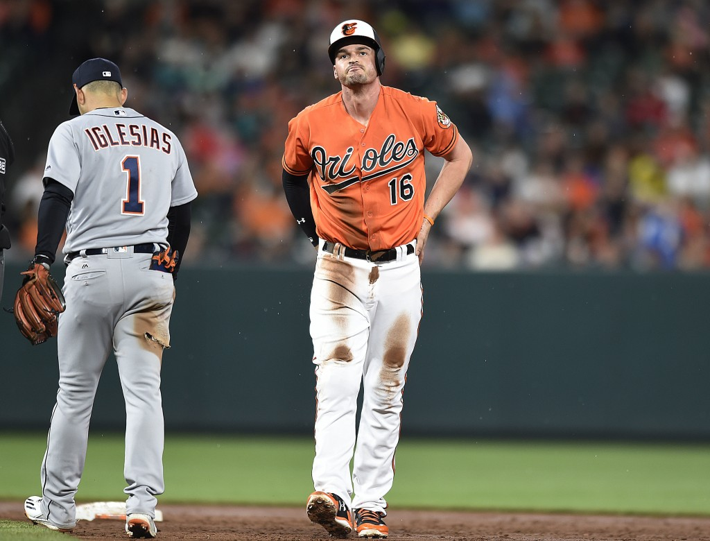 Baltimore Orioles' Trey Mancini reacts after being called out at second on double play after a line drive hit by Jace Peterson against the Detroit Tig...