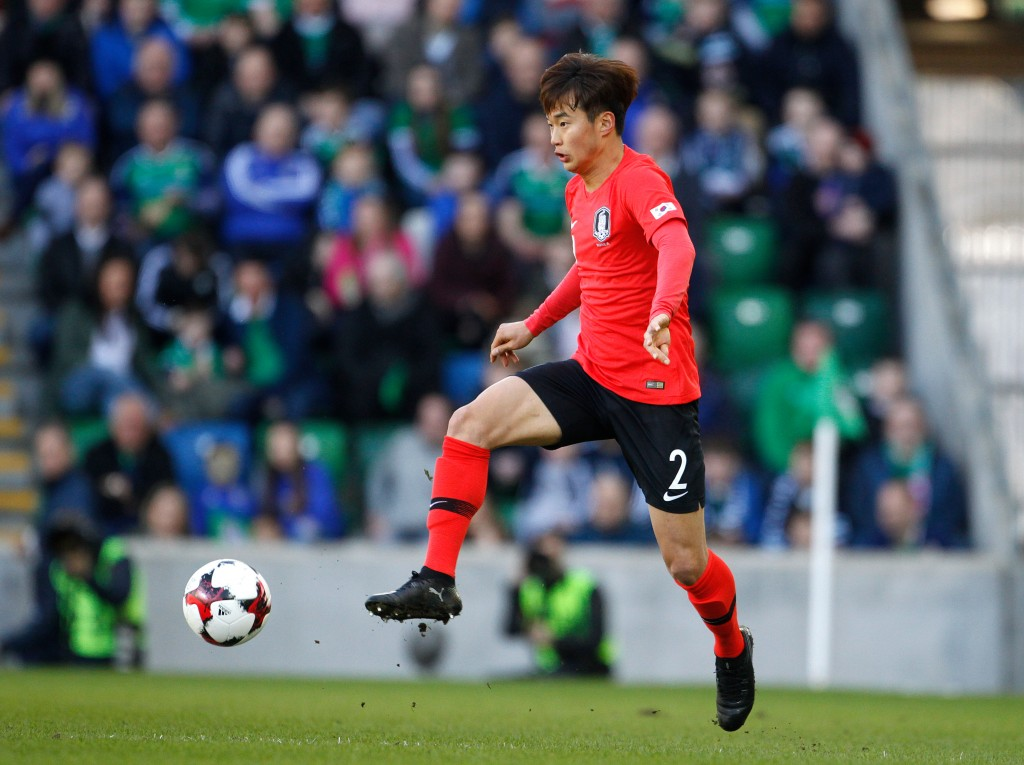 In this photo taken on Saturday, March, 24, 2018, South Korea's Kim Jin-su goes for the ball during a friendly soccer match between Northern Ireland a...
