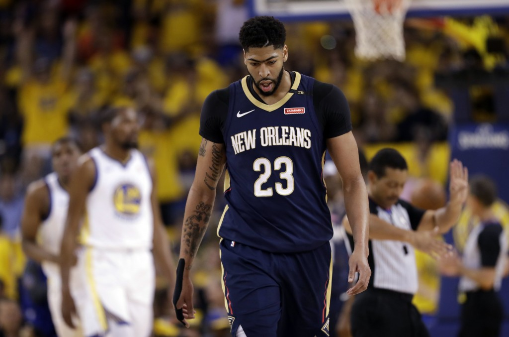 New Orleans Pelicans' Anthony Davis walks back to the bench during a break in the action during the first half in Game 1 of the team's NBA basketball ...
