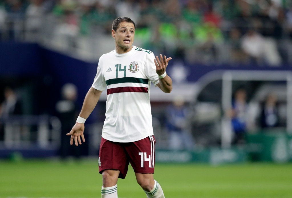 In this image taken on Tuesday, March 27, 2018 Mexico forward Javier Hernandez jogs across the field talking to an official, not pictured, during a in...