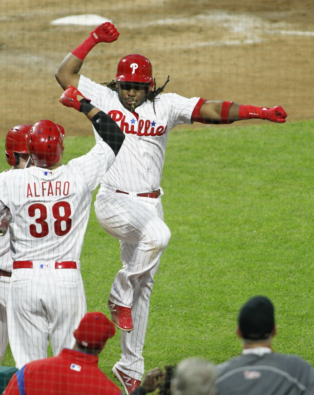 Philadelphia Phillies' Maikel Franco celebrates his solo home run as he returns to the dugout during the fifth inning of the team's baseball game agai...